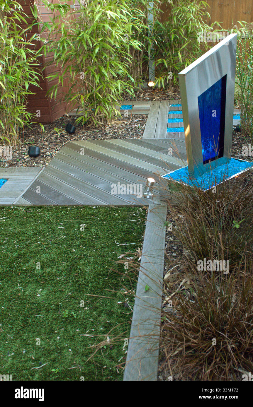 modern landscaped garden with water feature and astro-turf lawn and decking Stock Photo