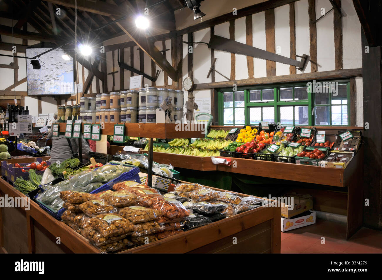 Interior of retail farm shop fruit and general produce on display - Stock Image