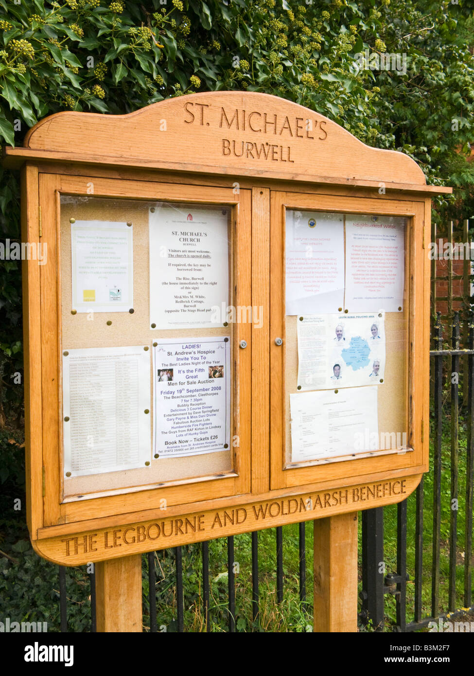 Wooden parish church notice board with community information - Stock Image