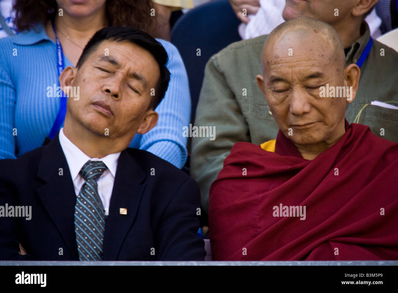 The Dalai Lama s visit to Seattle 04 12 2008 Seattle Qwest Field A monk and a man in the business suit take a nap - Stock Image