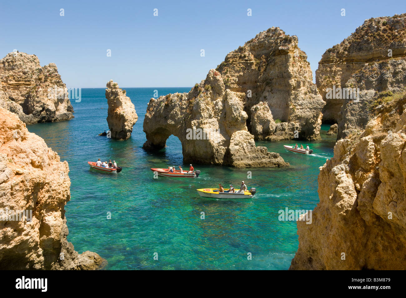 Portugal the Algarve near Lagos Ponta da Piedade tourist boats Stock Photo: 19499853 - Alamy