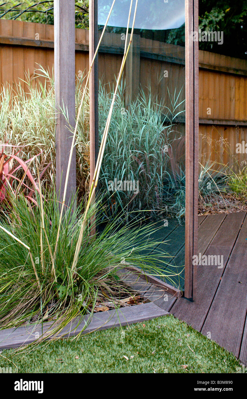 tinted perspex and wood gazebo in landscaped garden Stock Photo