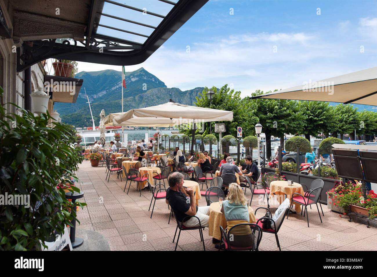 Lakefront Terrace Bar of the Hotel Metropole, Bellagio, Lake Como, Lombardy, Italy - Stock Image