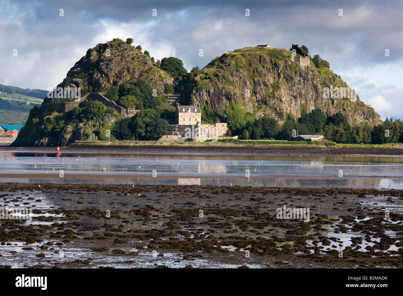 Dumbarton Rock and Dumbarton castle at low tide from West Ferry on the river Clyde, Scotland. - Stock Image