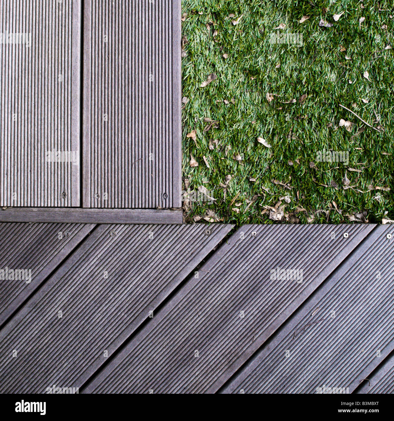 decking edges meet astro turf lawn Stock Photo