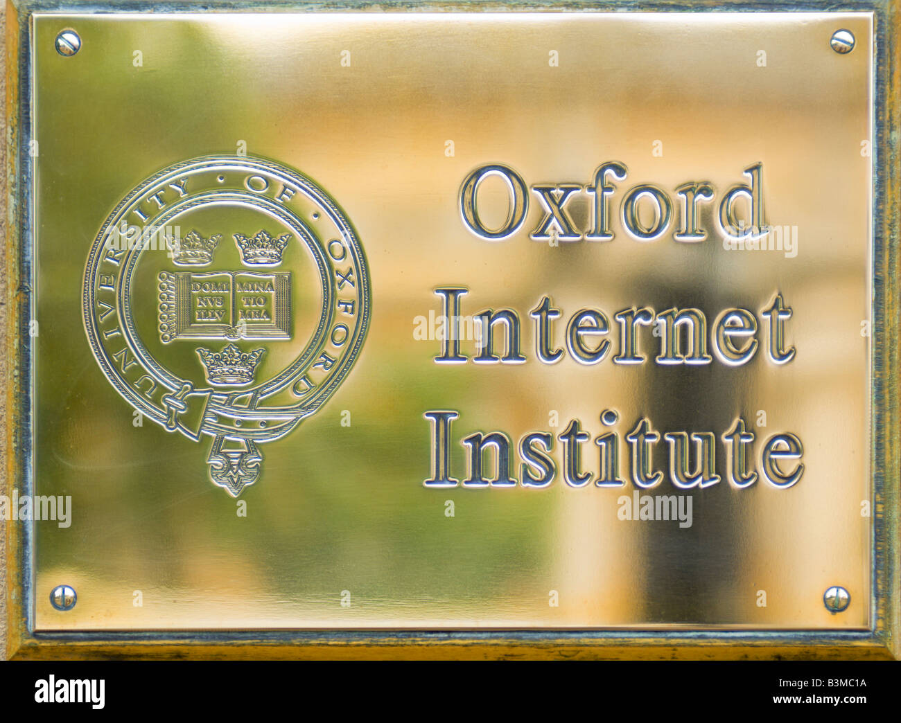 Brass plate sign outside the University of Oxford Internet Institute. - Stock Image