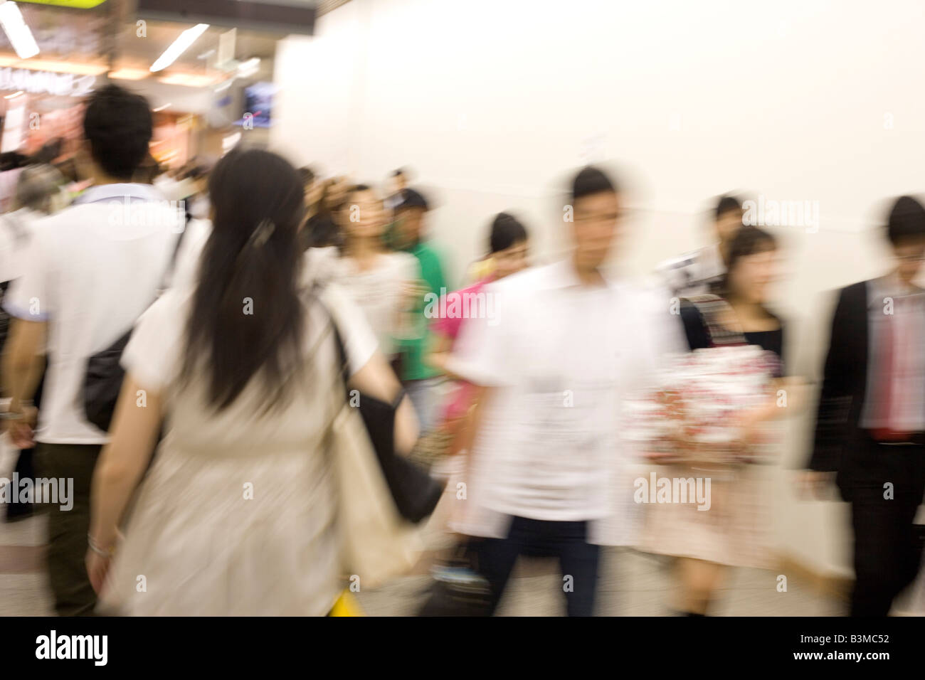 japanese commuters walking through subway station, rush hour, shinjuku, Tokyo Japan - Stock Image