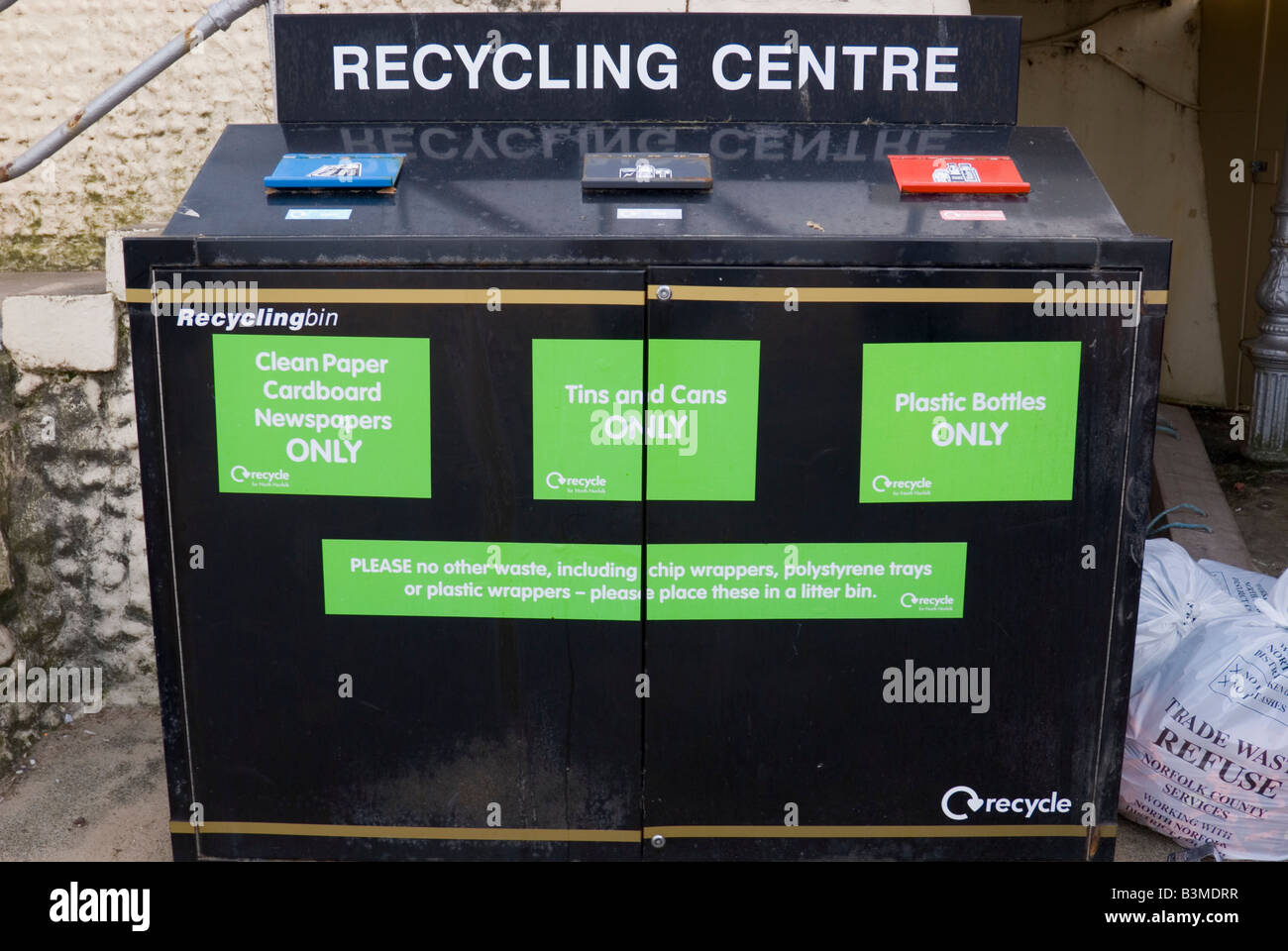 Recycling Centre With different openings for different waste items - Stock Image