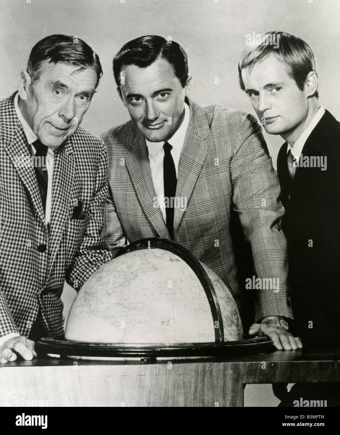 THE MAN FROM U.N.C.L.E.   US NBC Sixties TV series with from left Leo G Carroll, Robert Vaughn  and  David McCallum - Stock Image