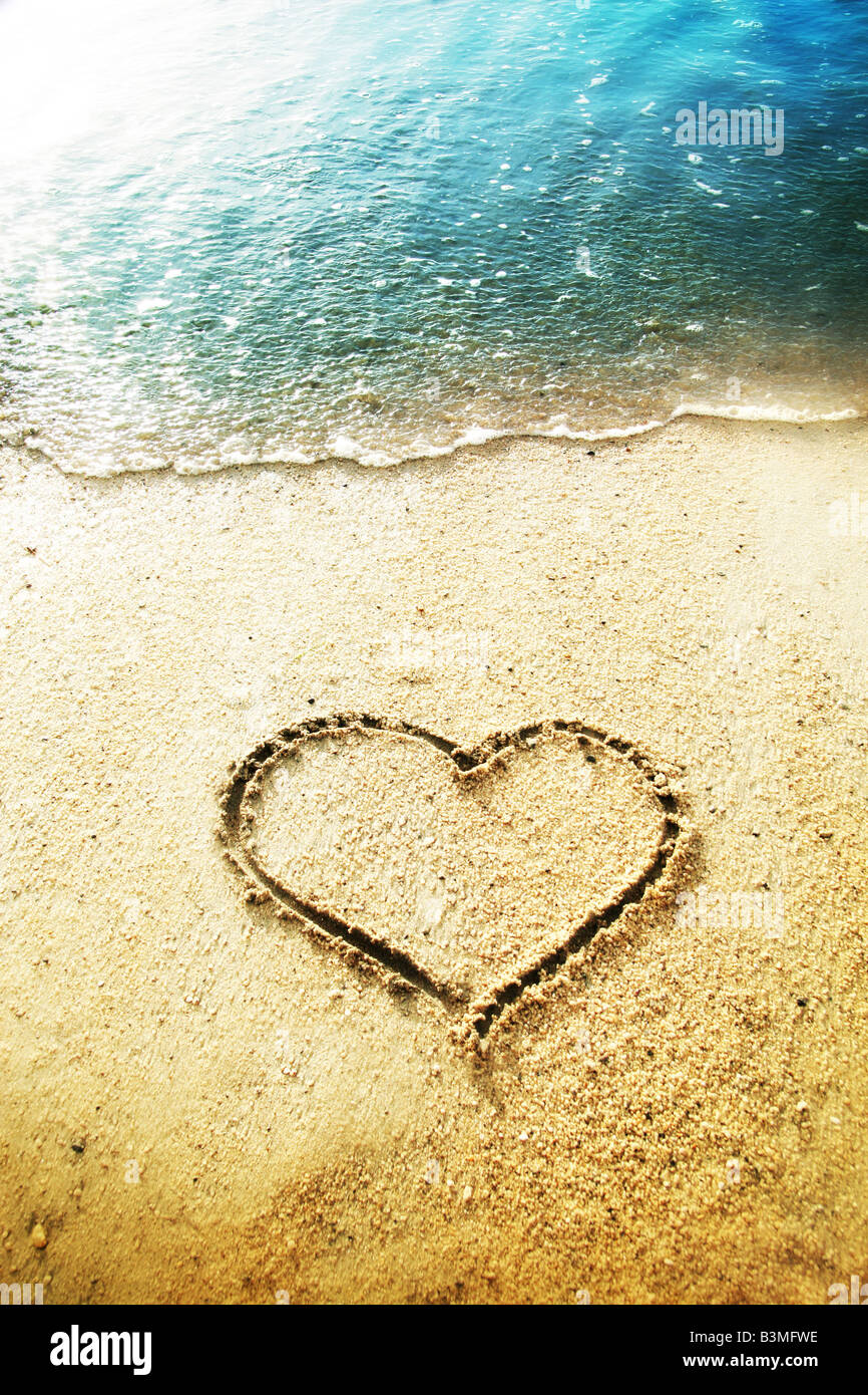 heart shape drawn in the sand - Stock Image