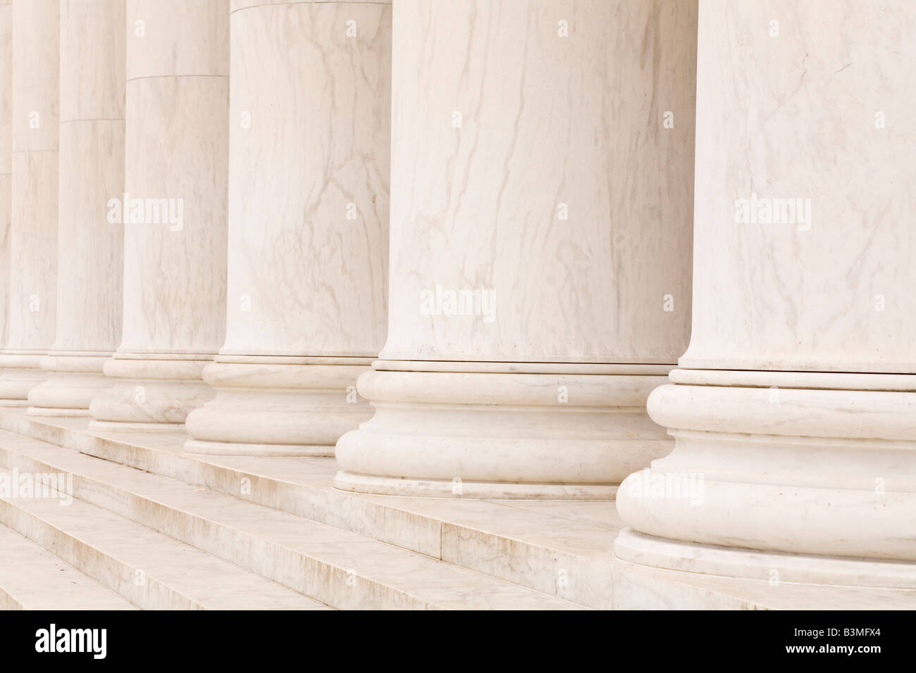 Marble stone columns in a row and steps, ideal for classic background Stock Photo