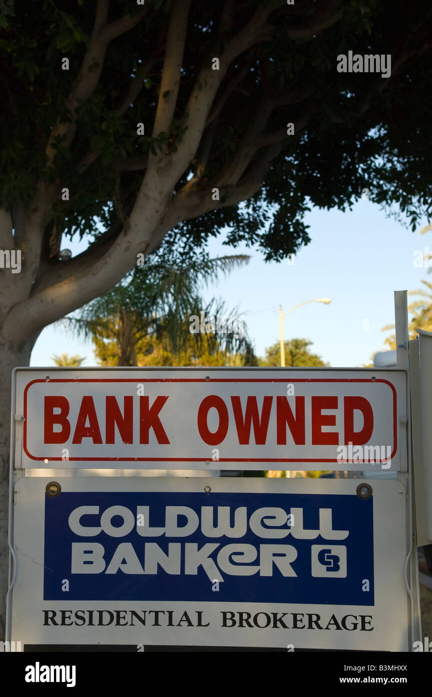Bank Owned sign in the streets of Indio in southern California by the  foreclosed property. - Stock Image