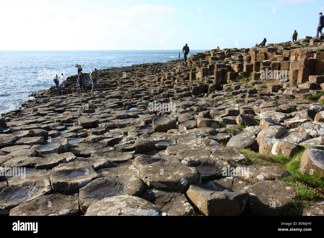 Visitors on the Giants Causeway - Stock Image