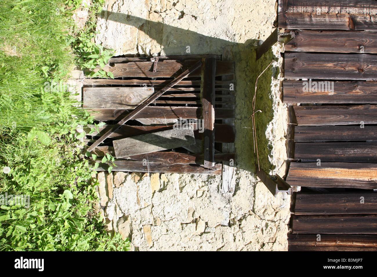 Dilapidated barn basement - Stock Image