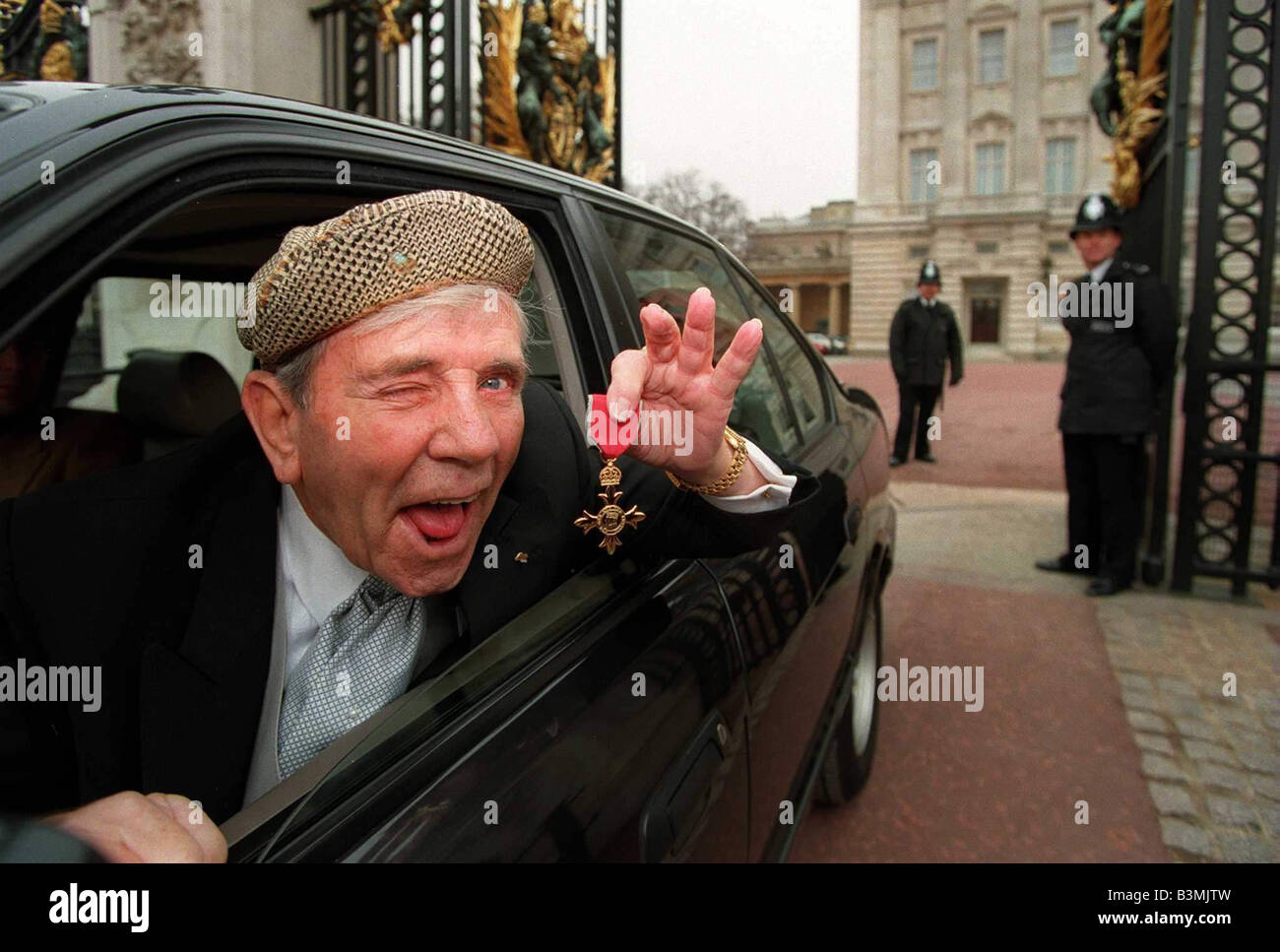 Norman Wisdom leaves Buckingham Palace with his OBE 4th February Norman Wisdom retires on his 90th birthday to spend - Stock Image