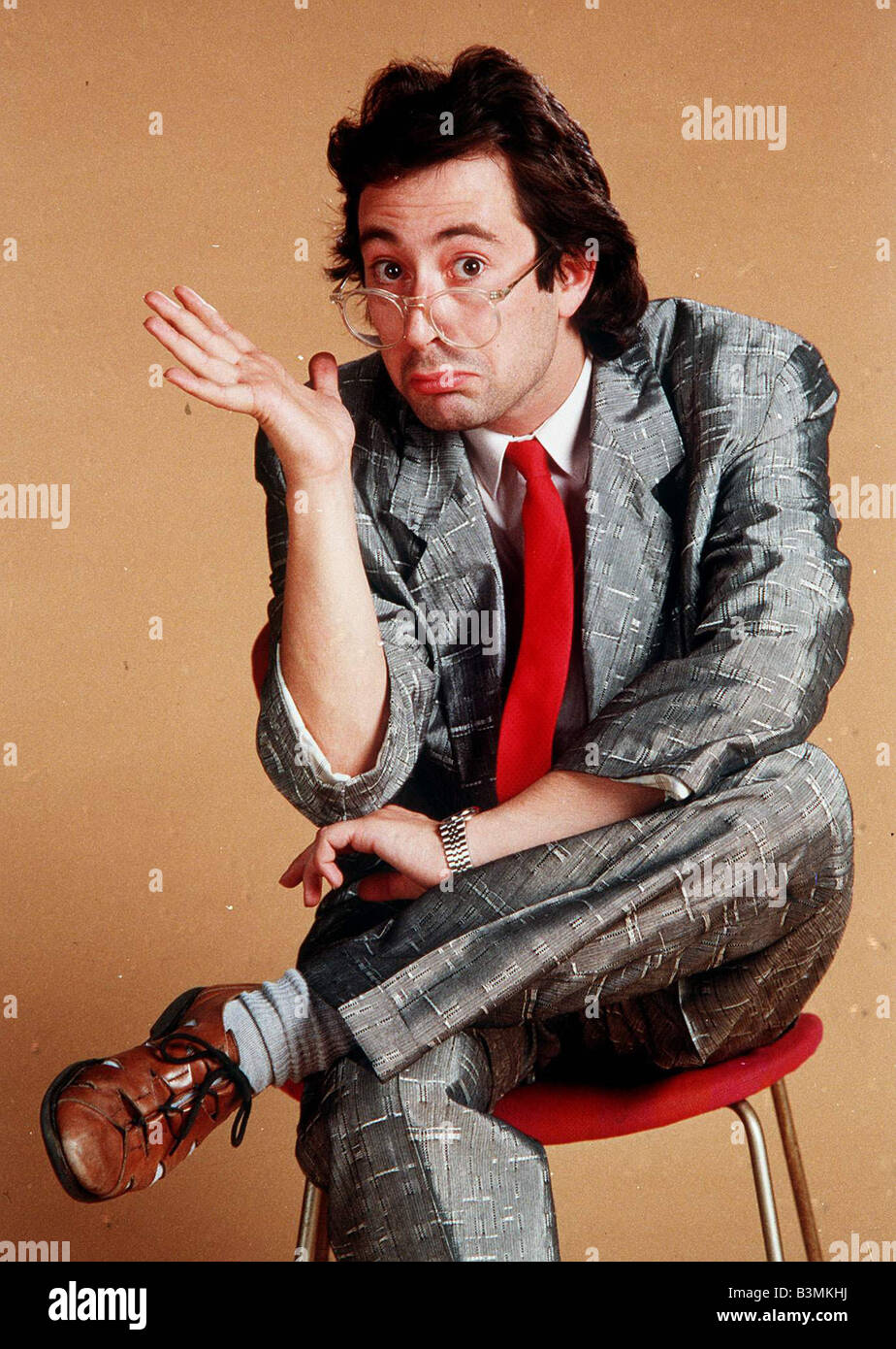 Ben Elton Comedian Sitting Hunched Over Mirrorpix Stock Photo