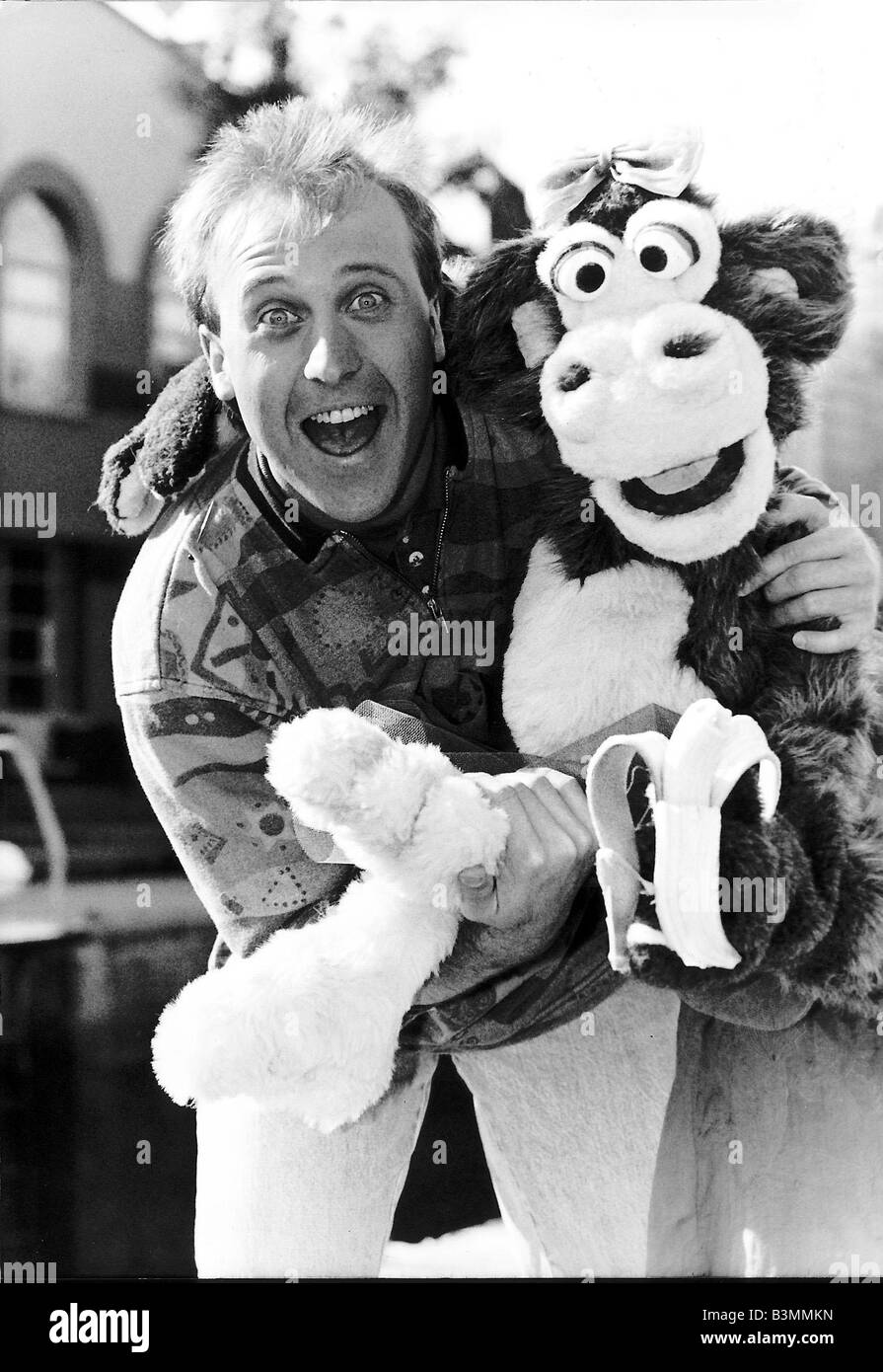 Mike Brosnan TV presenter with Chuck the Chimpanzee - Stock Image