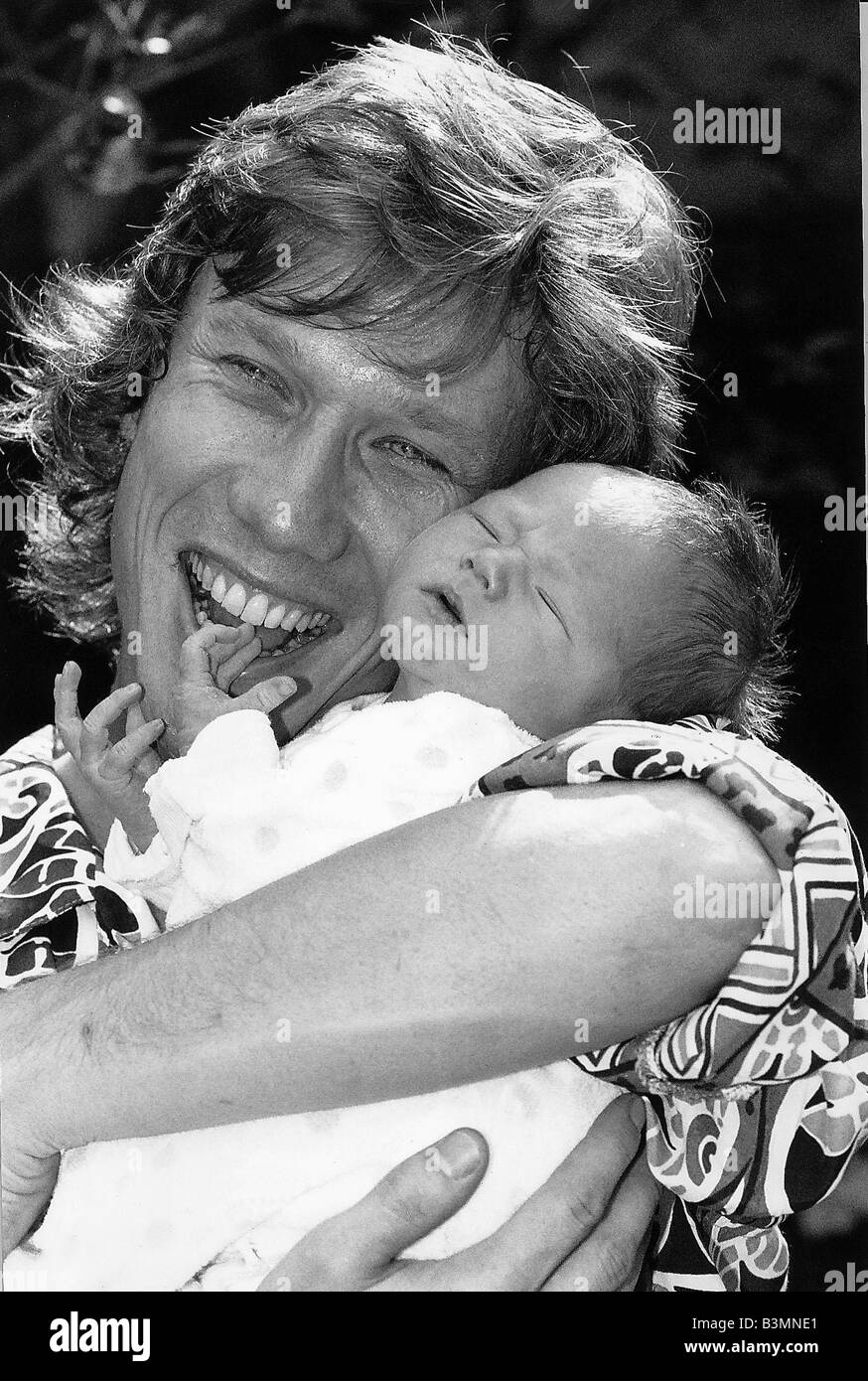 Peter Duncan TV Presenter who was on the Childrens TV Programme Blue Peter holding his new baby son Boris - Stock Image