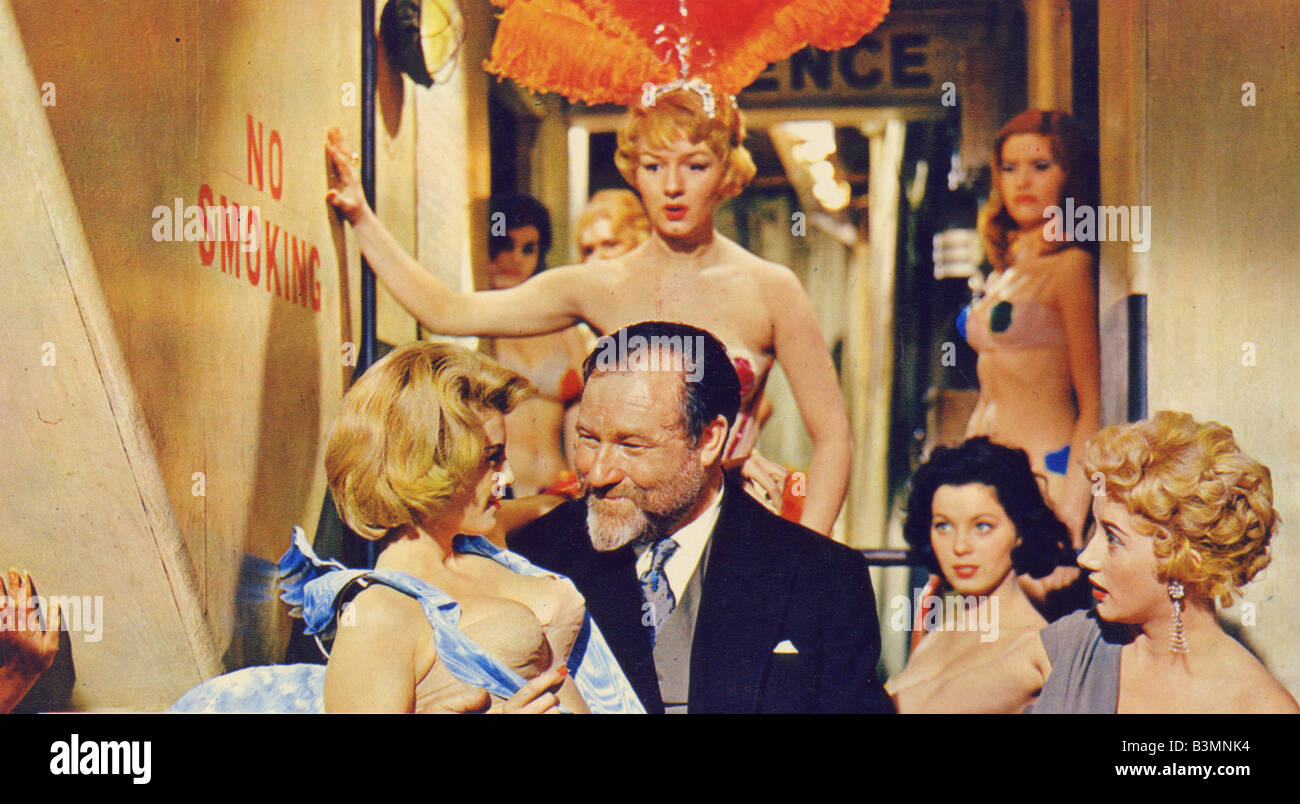 DOCTOR IN LOVE  1960 Rank film with James Robertson Justice with Joan Sims behind him - Stock Image