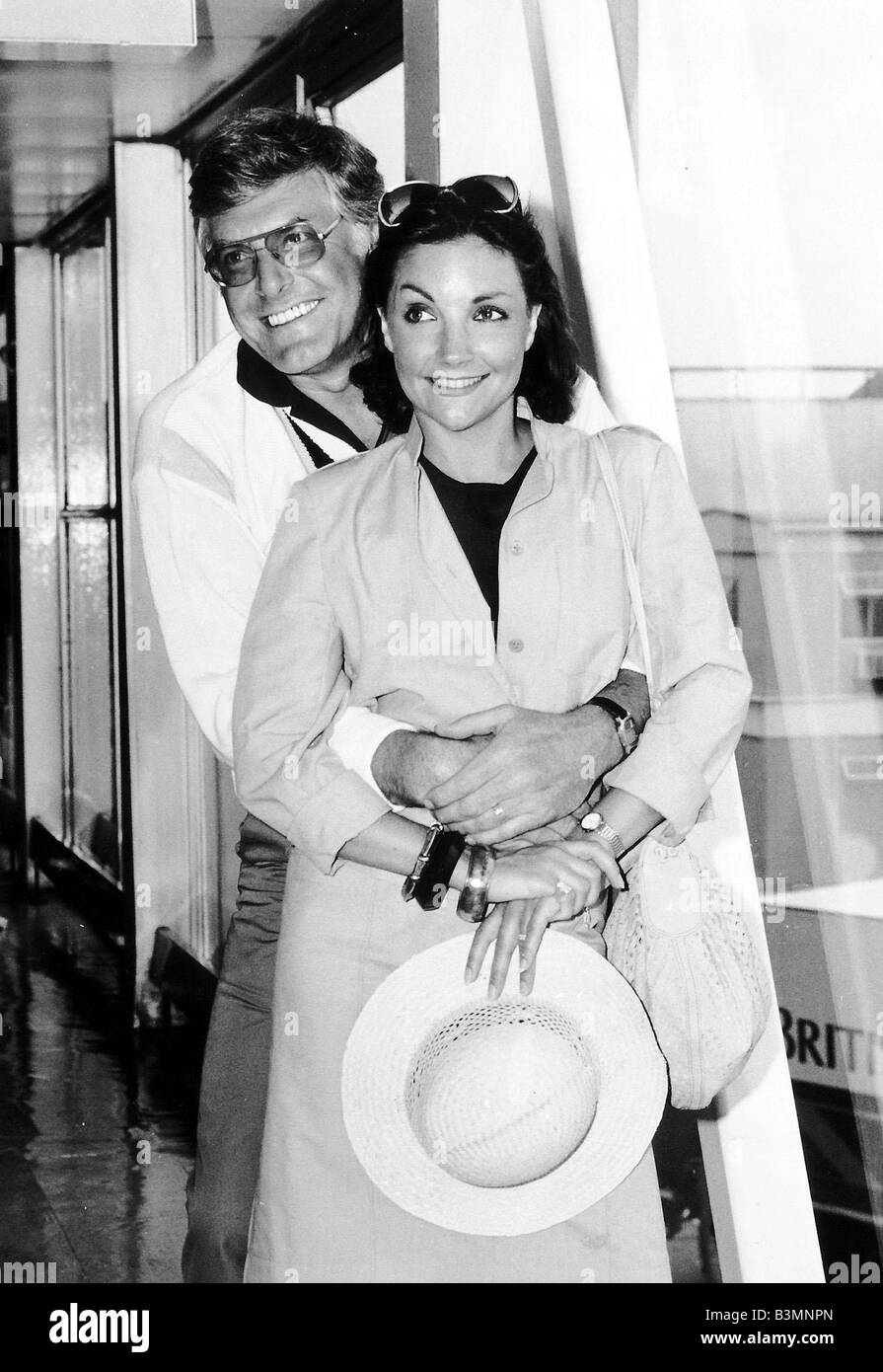 Kathryn Evans Singer and her husband Peter Purves TV Presenter at Heathrow airport after arriving from Barbados - Stock Image