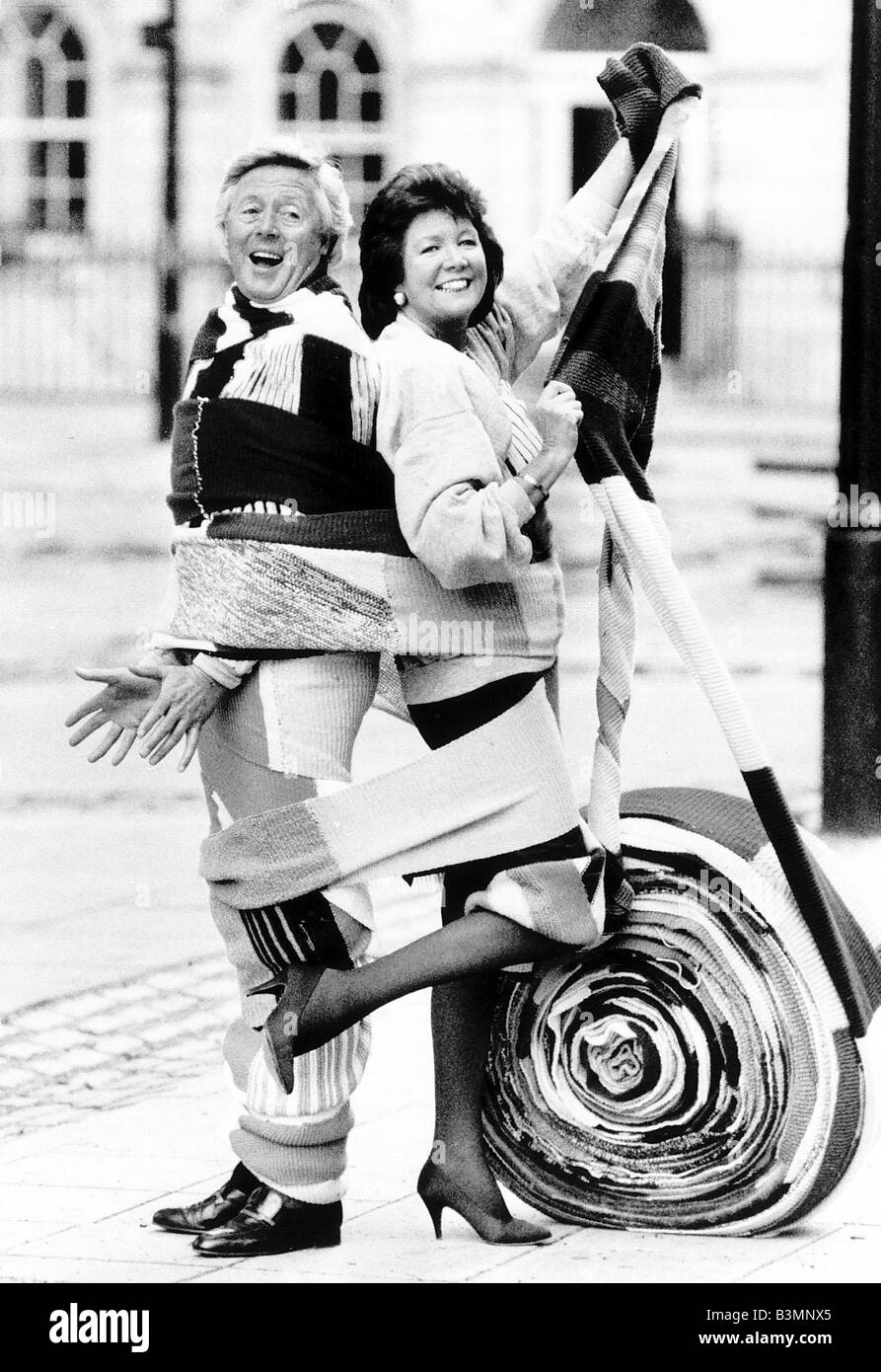 Michael Aspel tv presenter with Cilla Black tv presenter and singer trying to raise money for charity - Stock Image