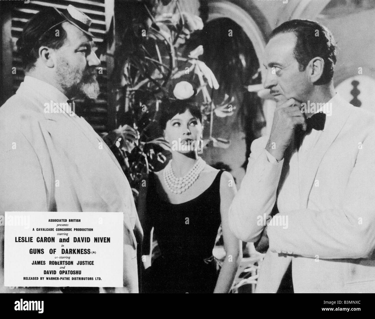 GUNS OF DARKNESS  1962 ABP film with from l: James Robertson Justice, Leslie Caron and David Niven - Stock Image