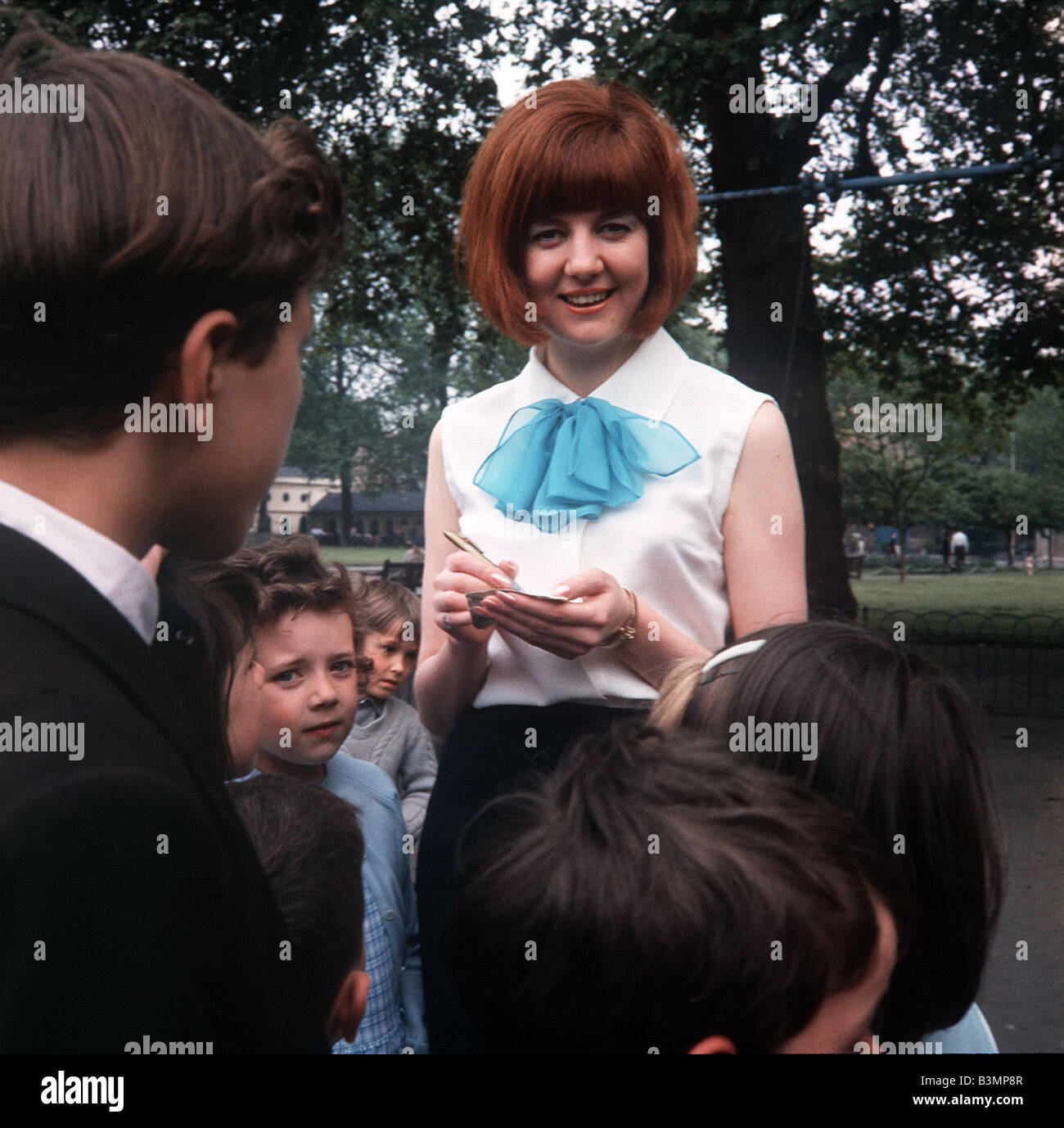 Cilla Black Singer Tv Presenter Stands Signing Autographs For Young Children