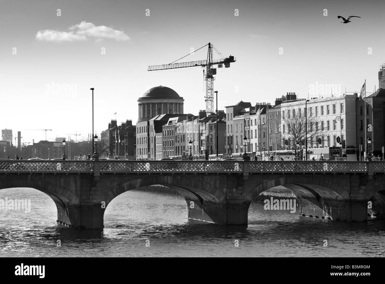 Black and White photograph of the River Liffey and modern Dublin, Ireland - Stock Image