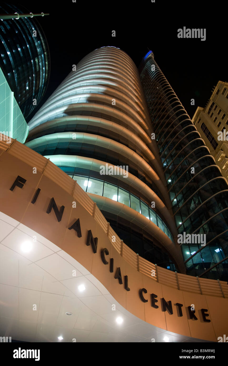 Qatar Financial Center Building Doha Middle East Exterior at night - Stock Image