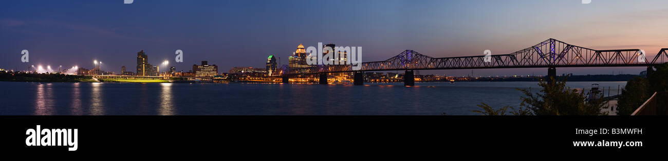 Panorama of Louisville Kentucky Skyline and the Ohio River at Twilight Shot from Jeffersonville Indiana - Stock Image