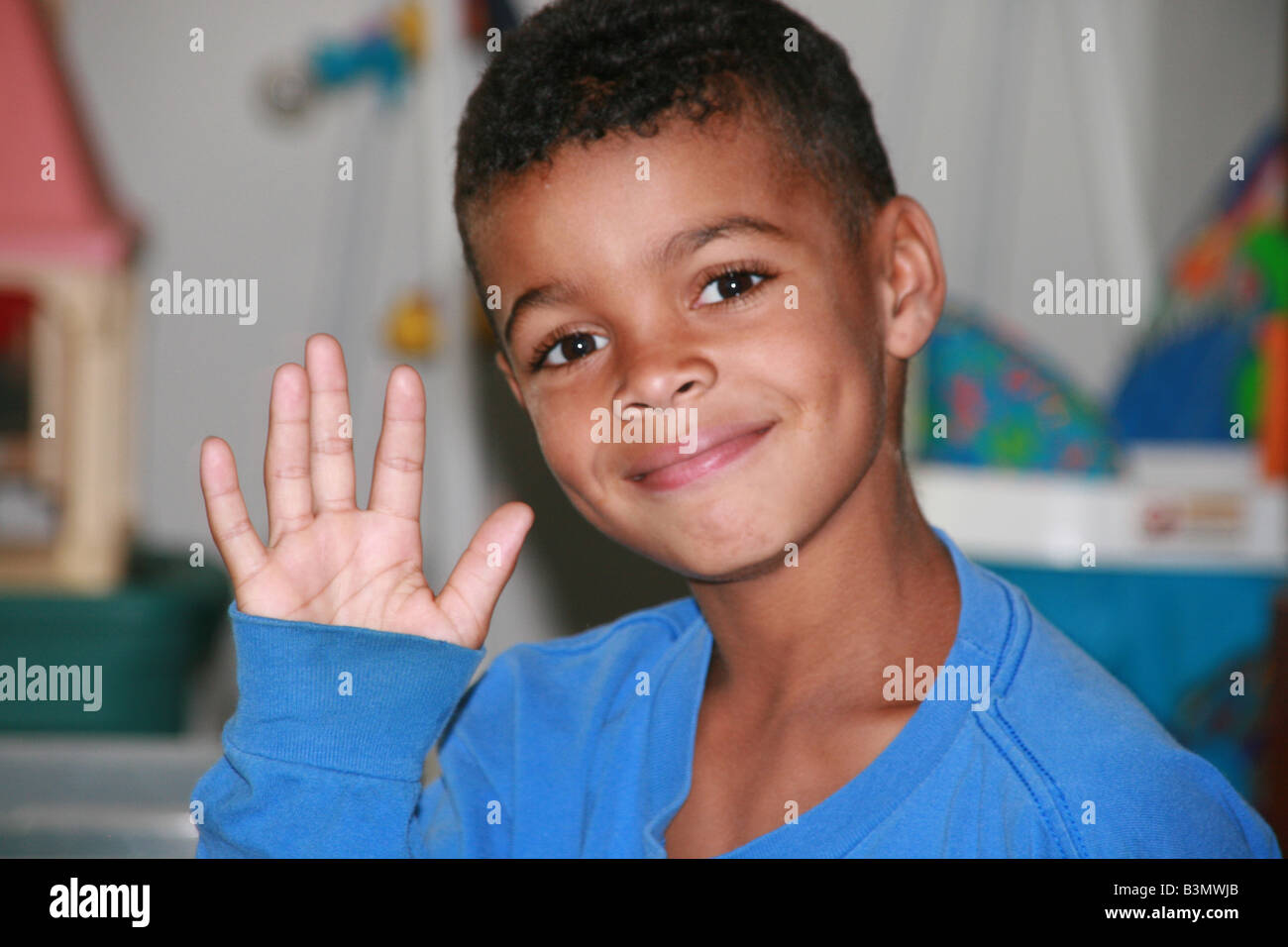 Happy Mixed Race African American Boy Waving His Hand