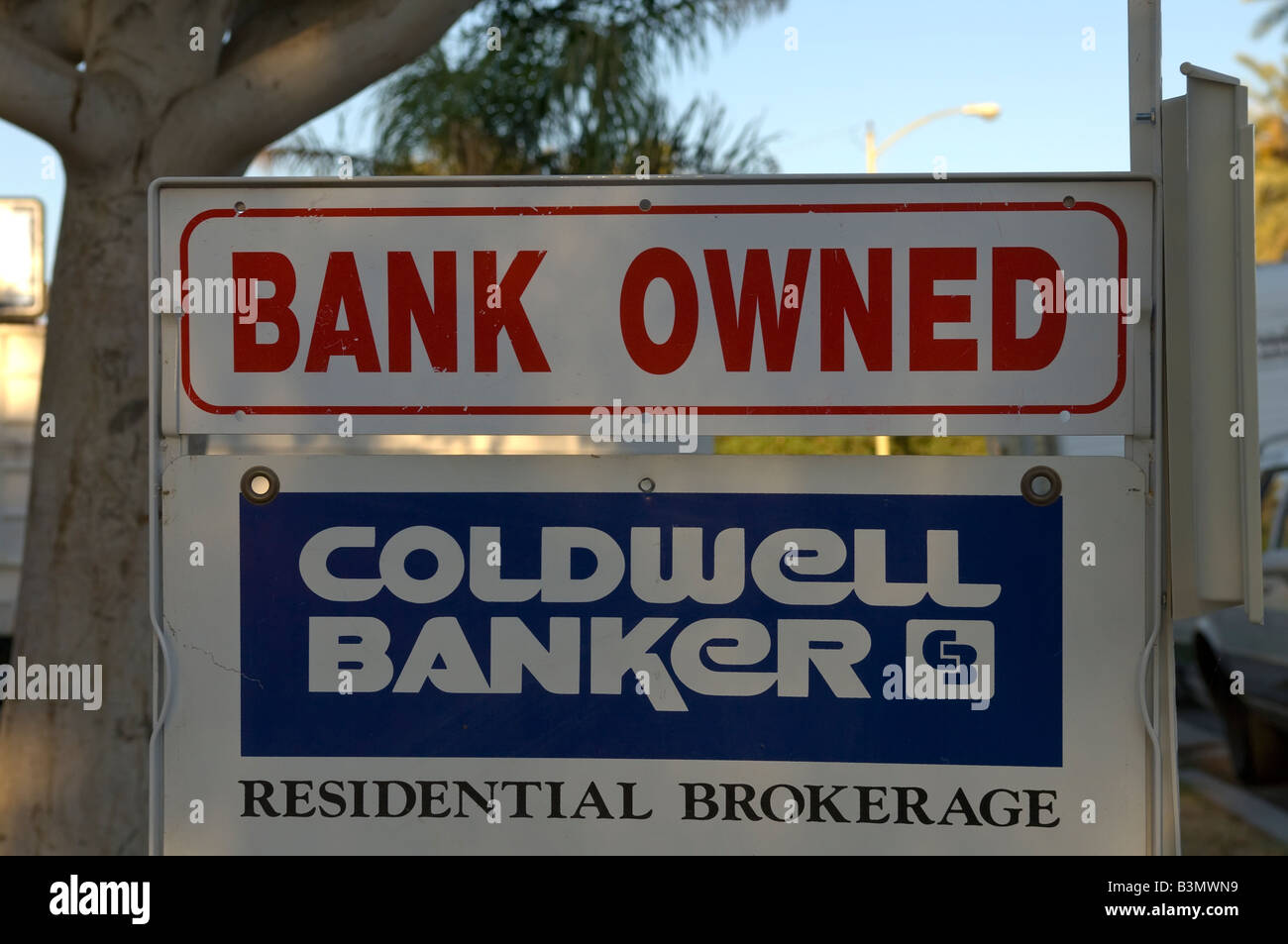 Bank Owned sign streets of Indio in Southern California foreclosed property - Stock Image