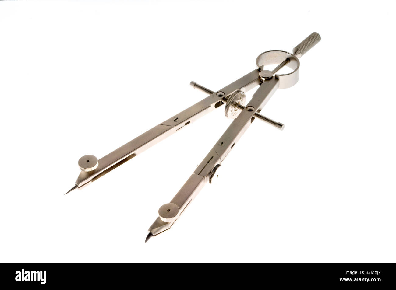 Mechanical compass on white - Stock Image