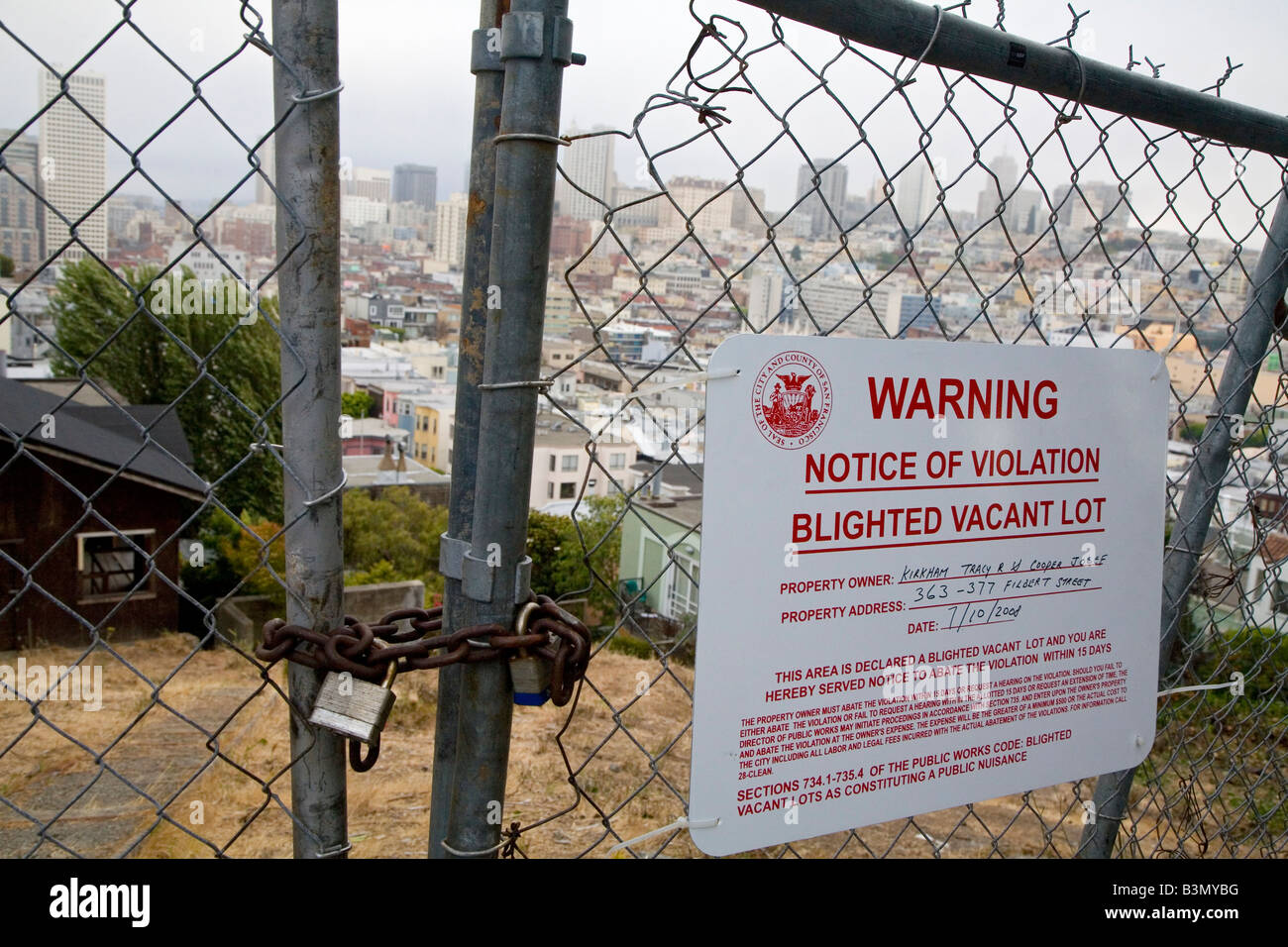 Government Notice Warns Property Owner to Correct Blighted Condition of Vacant Lot - Stock Image
