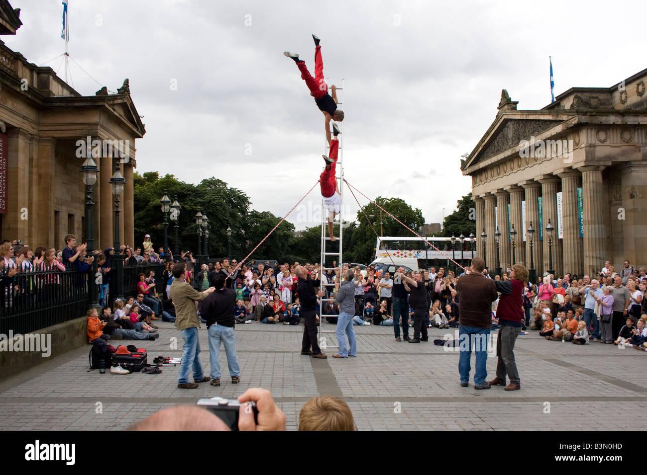 Acrobats street act at the Fringe Festival outside the National Gallery of Scotland, Edinburgh Scotland - Stock Image