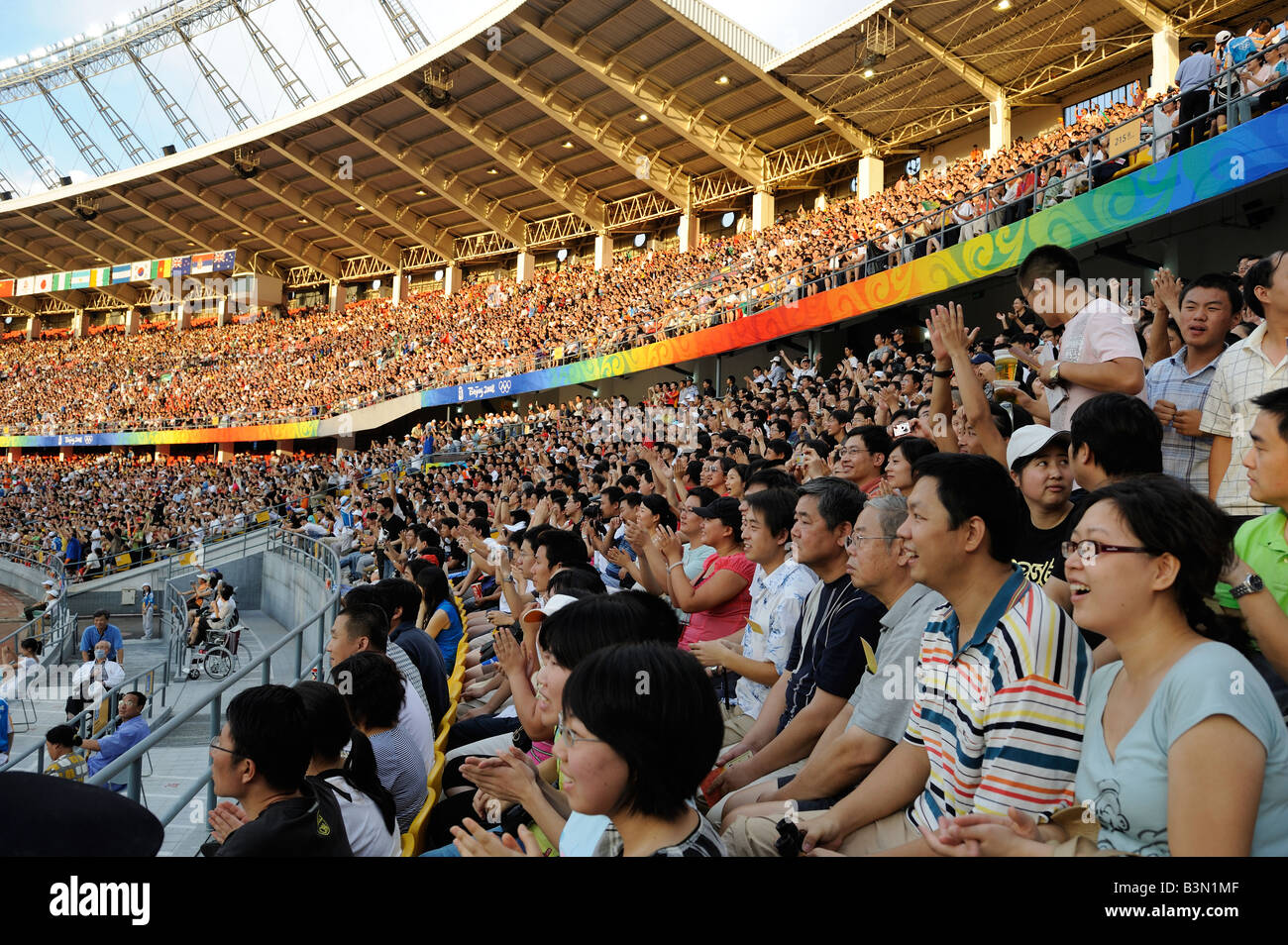 Chinese spectators watching a football game at the Beijing 2008 Olympic Games.16-Aug-2008 - Stock Image