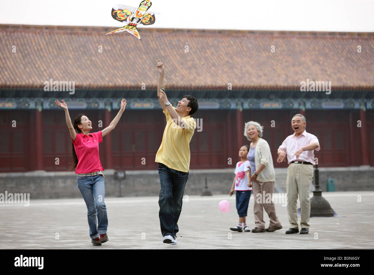 chinese families flying kites in the forbidden city,beijing,china - Stock Image