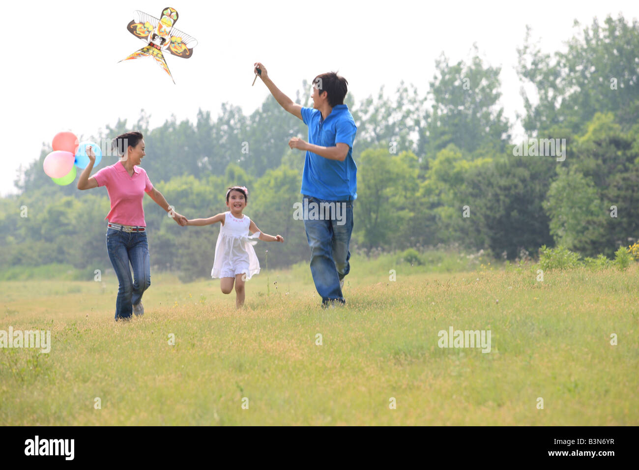 chinese families flying kites outdoors,beijing,china - Stock Image