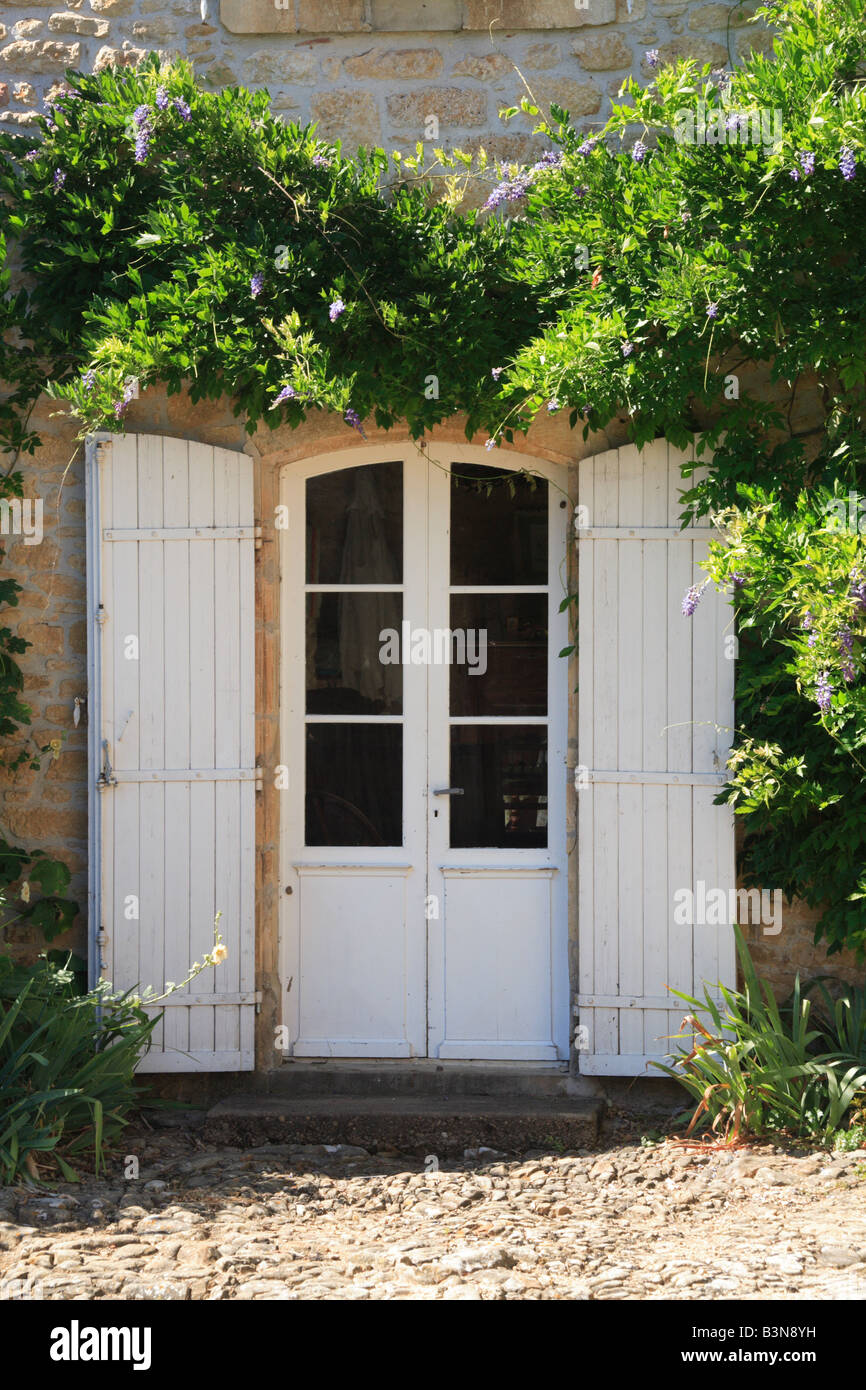 french doors with shutters. Limeuil Dordogne French Doors Shutters France - Stock Image With