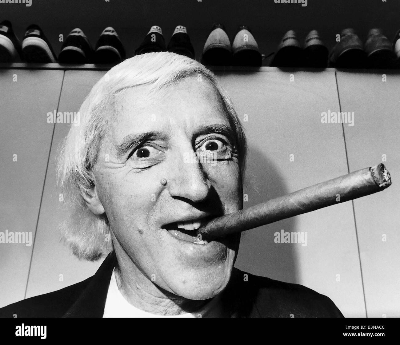 Jimmy Saville DJ TV Presenter smoking a large cigar - Stock Image