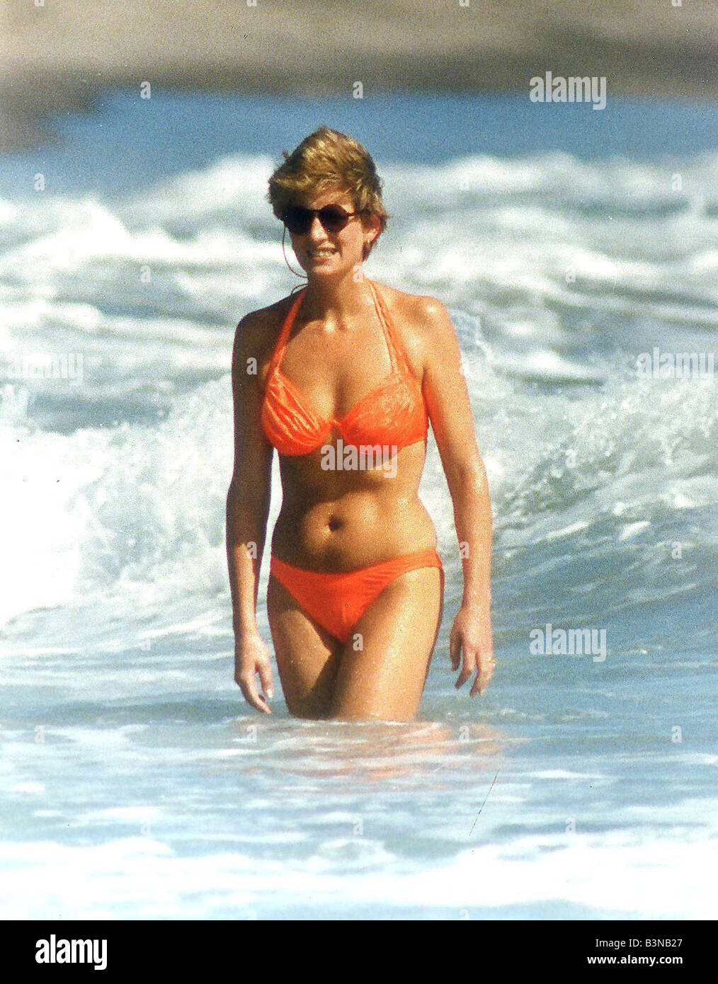 Princess Diana walking through the surf whilst on holiday with Prince William January 1993 - Stock Image