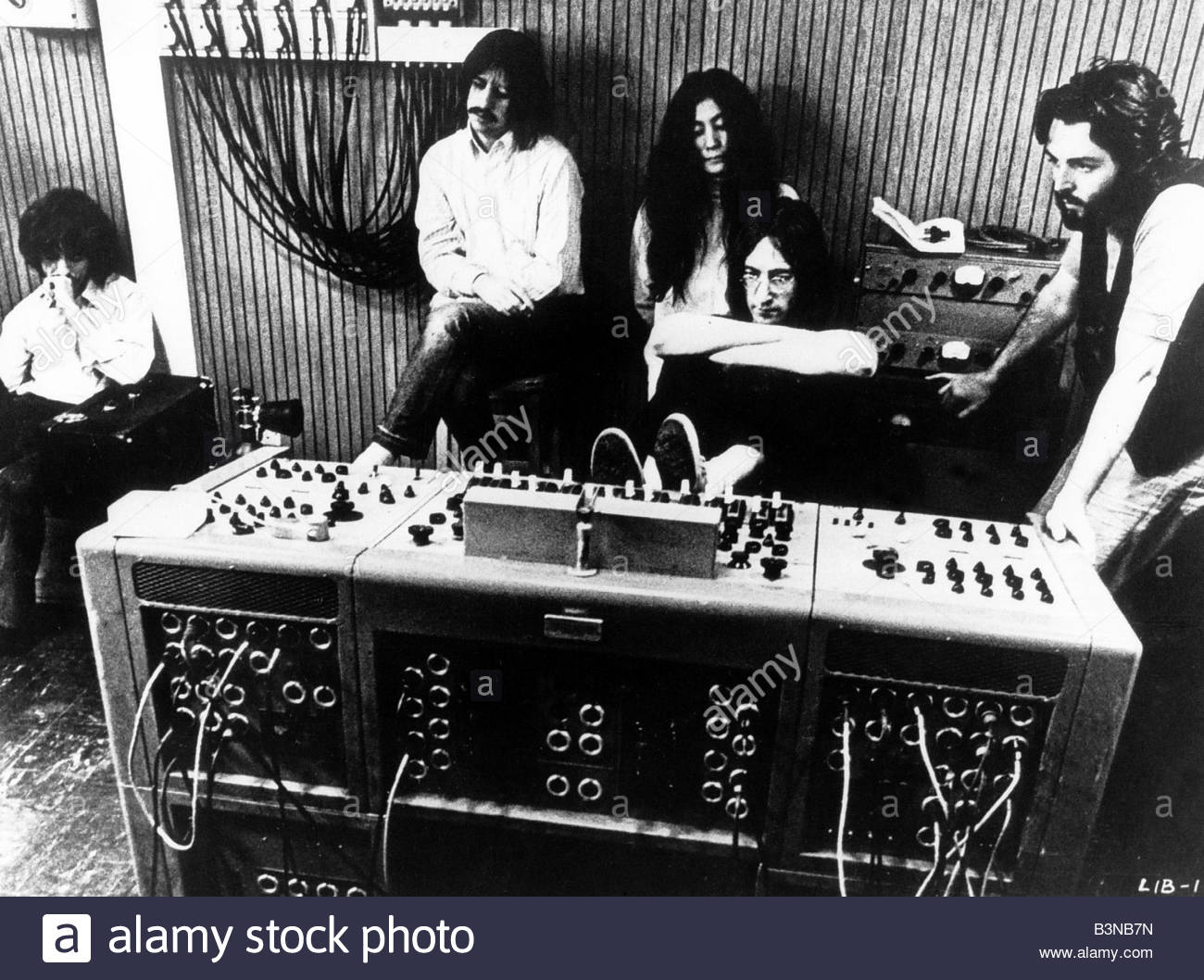 The Beatles listening to a playback of a song that they recorded for the film Let it Be in 1969 From left to right - Stock Image