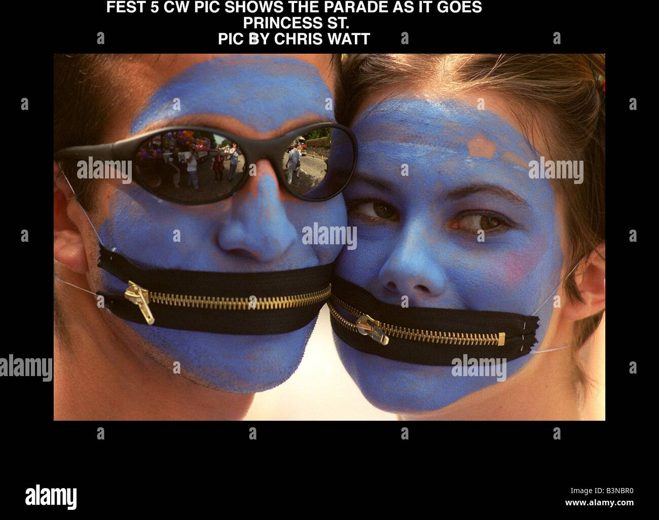 Edinburgh Festival Parade painted blue faces August 1997 With zip fasteners for mouths - Stock Image
