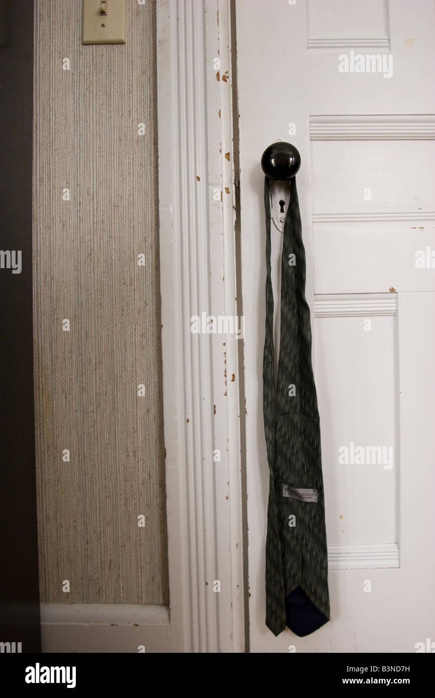 necktie hanging on doorknob Stock Photo: 19525733 - Alamy