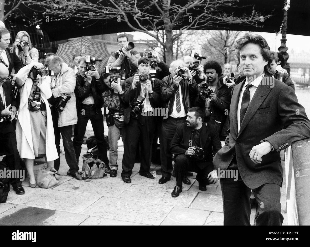 Michael Douglas actor leans on wall being photographed - Stock Image