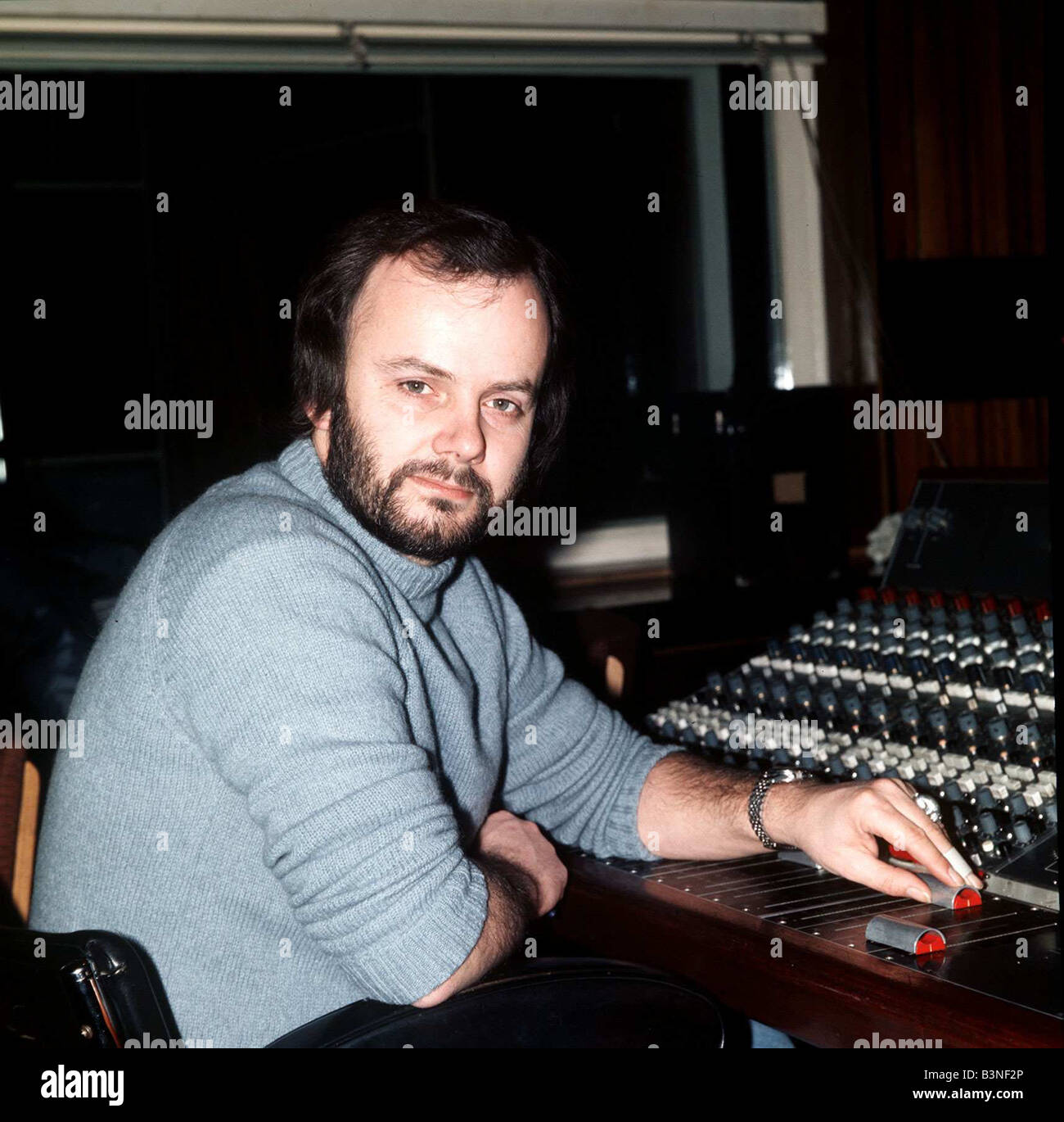 DJ John Peel in radio one studio sitting by mixing desk 1976 John Peel BBC Radio 1 s longest serving DJ mirrorpix - Stock Image