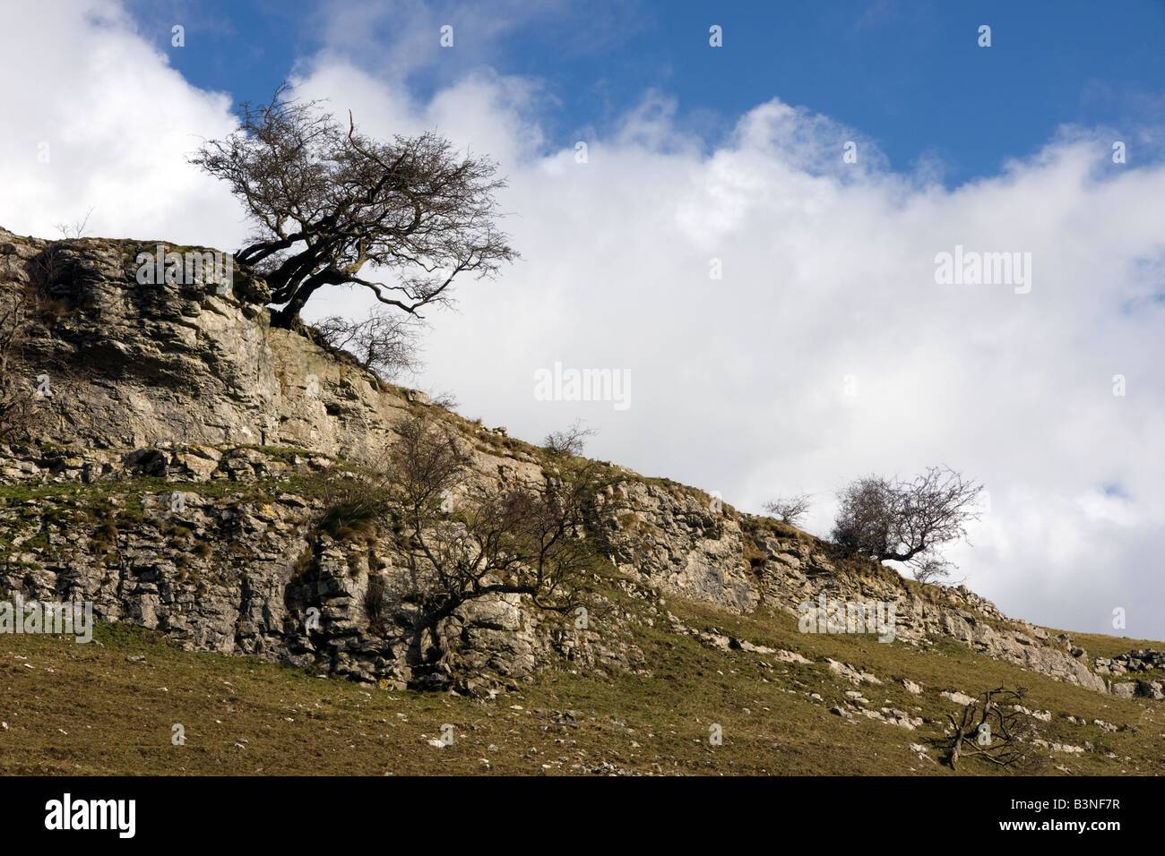 cressbrook dale landscape showing geological features rocks and clouds - Stock Image
