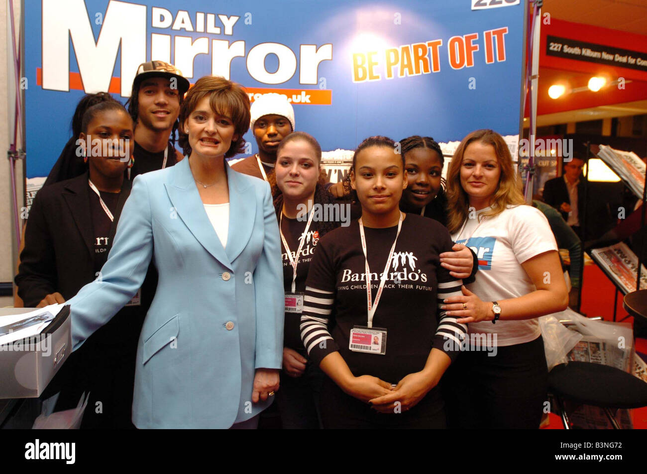 Cherie Blair takes a group from Barnardos who are learning how to produce a newspaper to the Daily Mirror stand - Stock Image