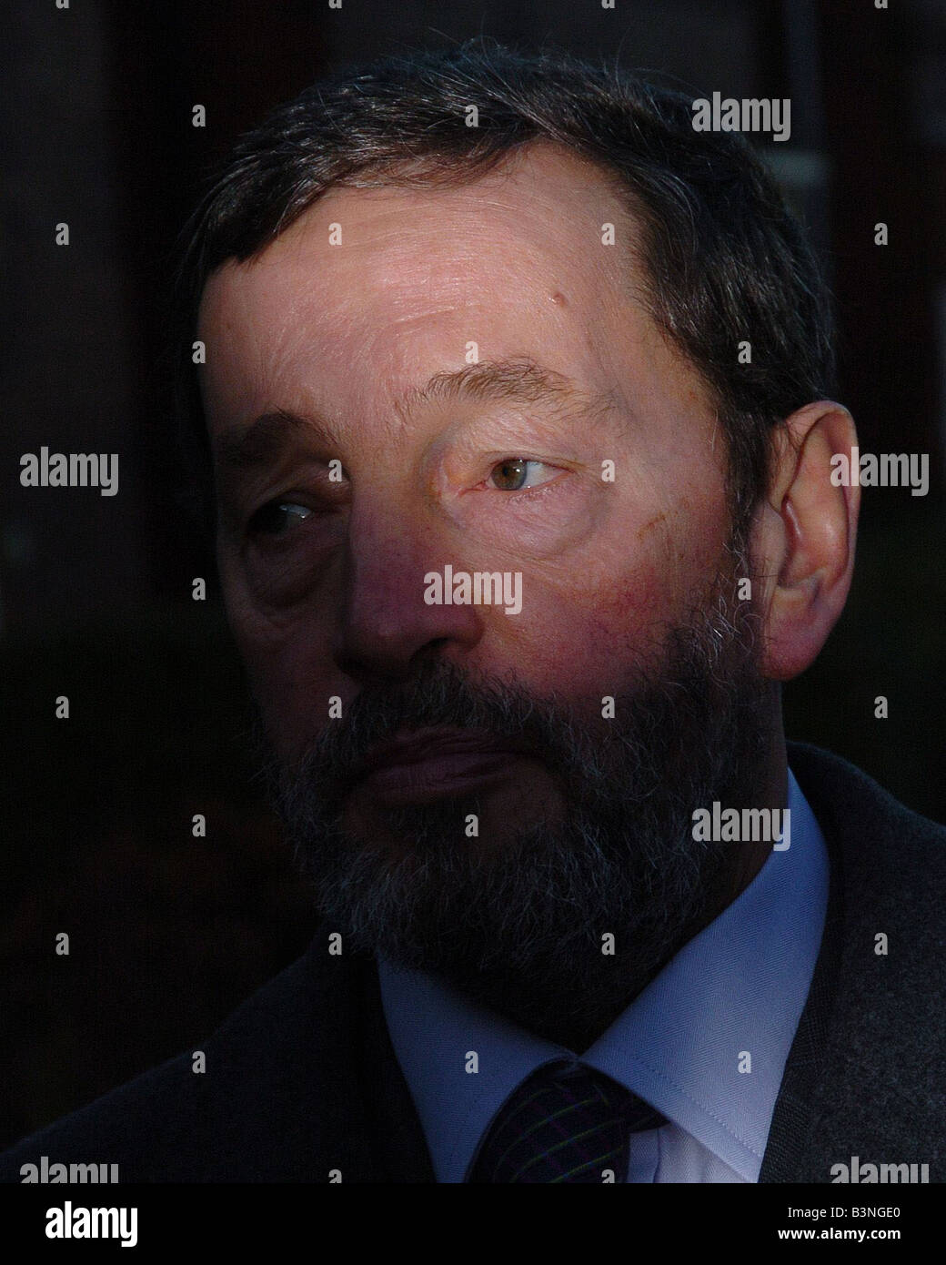 The shadowy world of David Blunkett as he leaves his Sheffield home December 2004 - Stock Image