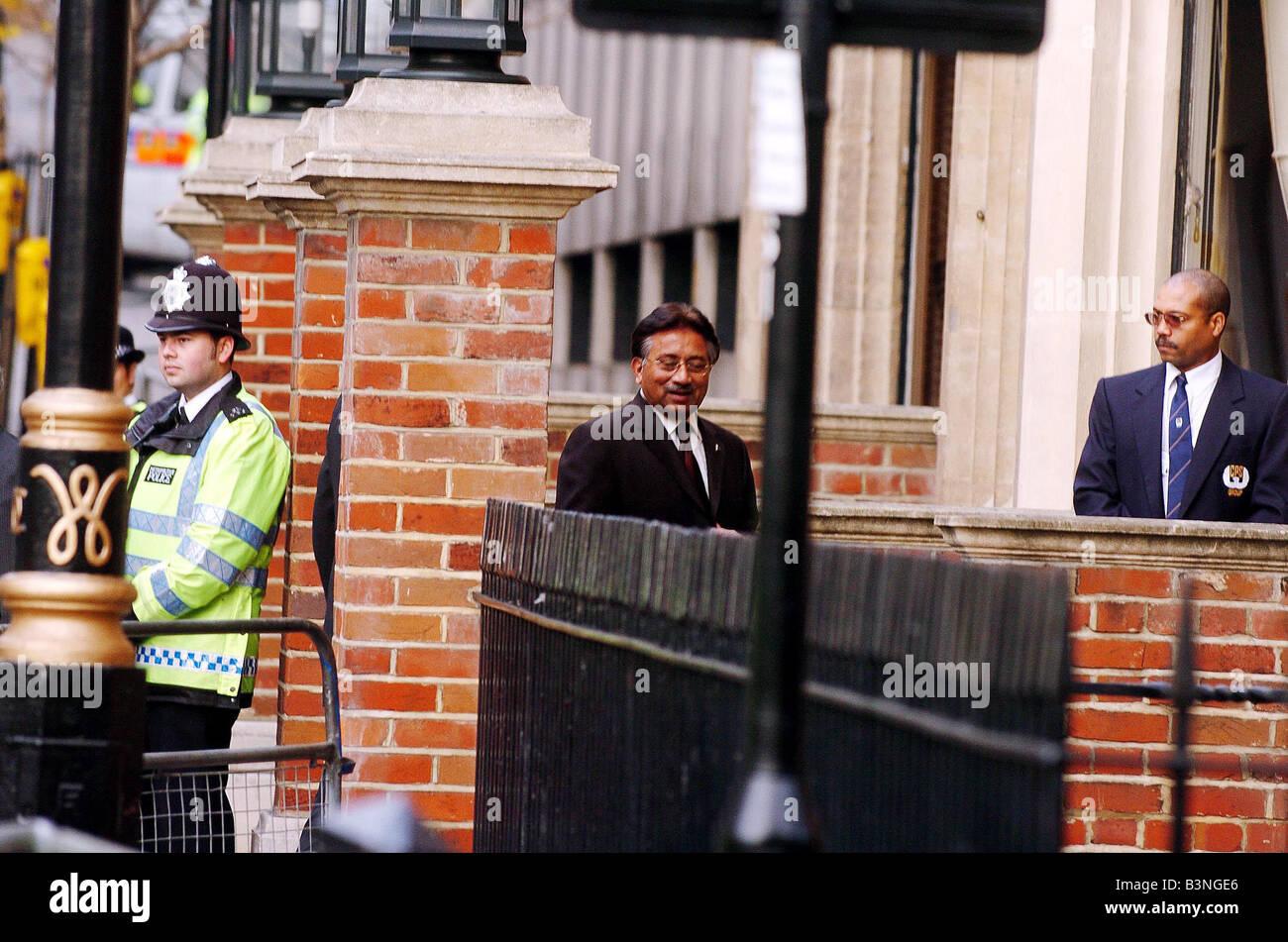 Police security surrounding Pakistani President Pervez Musharraf outside the Institute of Strategic Studies in Londons - Stock Image